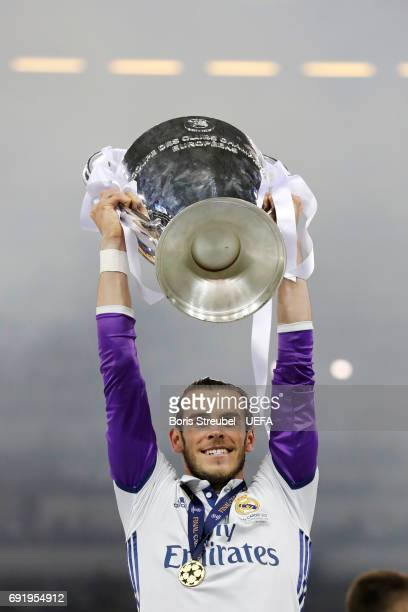 Gareth Bale of Real Madrid lifts The Champions League trophy after the UEFA Champions League Final between Juventus and Real Madrid at National...