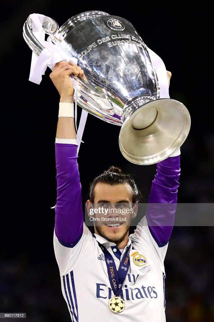 Gareth Bale of Real Madrid lifts the trophy following the UEFA Champions League Final match between Juventus and Real Madrid at the National Stadium of Wales on June 3, 2017 in Cardiff, Wales.