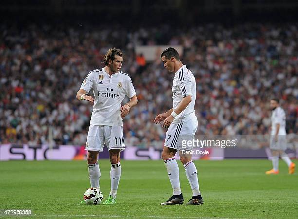 Gareth Bale of Real Madrid lines up a free kick with teammate Cristiano Ronaldo during the La Liga match between Real Madrid CF and Valencia CF at...