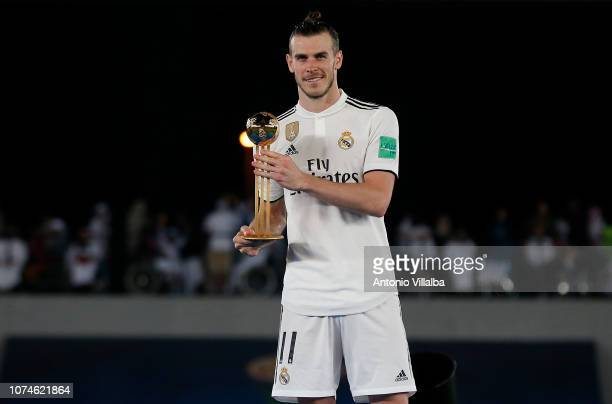 Gareth Bale of Real Madrid poses with his Adidas Golden Ball award after the FIFA Club World Cup UAE 2018 Final between Al Ain and Real Madrid at the...