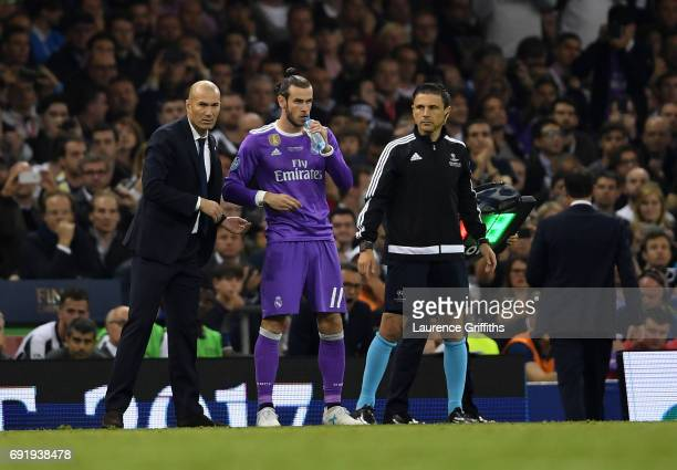 Gareth Bale of Real Madrid prepares to come on during the UEFA Champions League Final between Juventus and Real Madrid at National Stadium of Wales...
