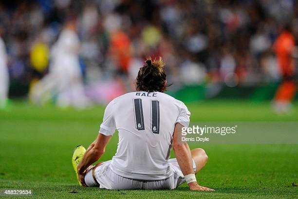 Gareth Bale of Real Madrid reacts after getting injured during the UEFA Champions League Group A match between Real Madrid and Shakhtar Donetsk at...