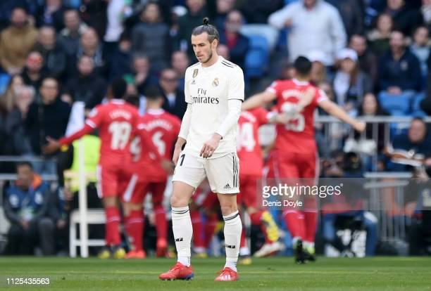 Gareth Bale of Real Madrid reacts after Portu of Girona scores his team's second goal during the La Liga match between Real Madrid CF and Girona FC...