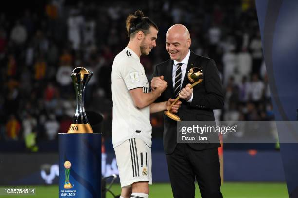 Gareth Bale of Real Madrid receives Adidas Golden Ball trophy from FIFA President Gianni Infantino during the medal ceremony after the match between...