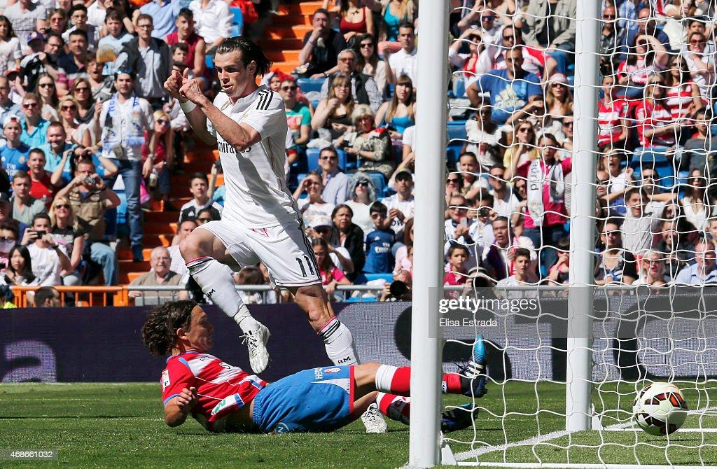 Gareth Bale of Real Madrid scores during the La Liga match between Real Madrid CF and Granda CF at Estadio Santiago Bernabeu on April 5, 2015 in Madrid, Spain.