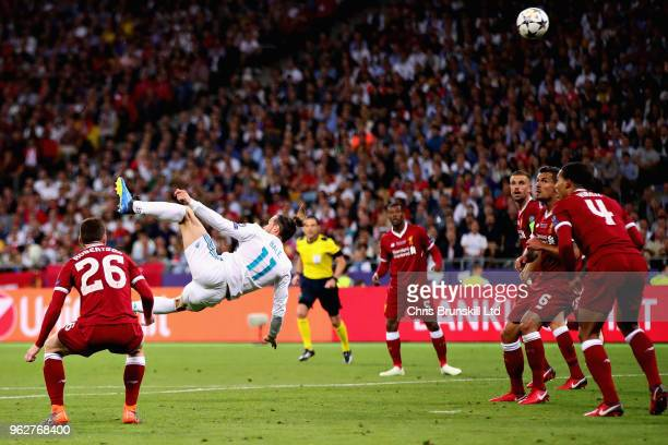 Gareth Bale of Real Madrid scores his sides second goal during the UEFA Champions League final between Real Madrid and Liverpool at NSC Olimpiyskiy...