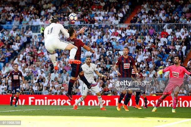 Gareth Bale of Real Madrid scores his team first goal during the La Liga match between Real Madrid CF and SD Eibar at Estadio Santiago Bernabeu on...