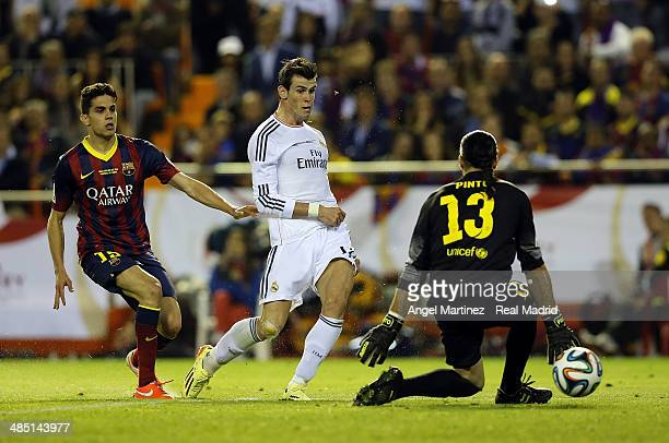 Gareth Bale of Real Madrid scores his team's second goal past Jose Manuel Pinto of Barcelona during the Copa del Rey Final between Real Madrid and...
