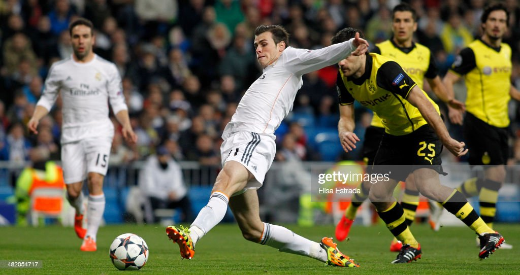 Gareth Bale of Real Madrid scores the first goal during the UEFA Champions League Quarter Final first leg match between Real Madrid and Borussia Dortmund at Estadio Santiago Bernabeu on April 2, 2014 in Madrid, Spain.