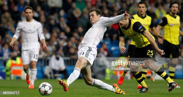 Gareth Bale of Real Madrid scores the first goal during the UEFA Champions League Quarter Final first leg match between Real Madrid and Borussia...