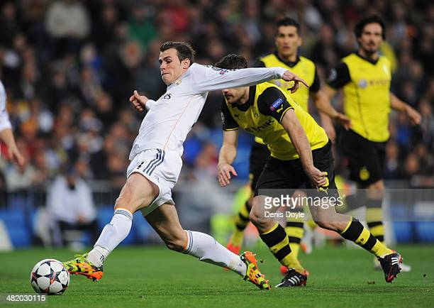 Gareth Bale of Real Madrid scores the opening goal during the UEFA Champions League Quarter Final first leg match between Real Madrid and Borussia...