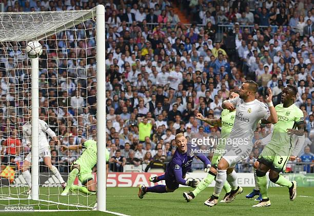 Gareth Bale of Real Madrid scores the opening goal during the UEFA Champions League semi final second leg match between Real Madrid and Manchester...