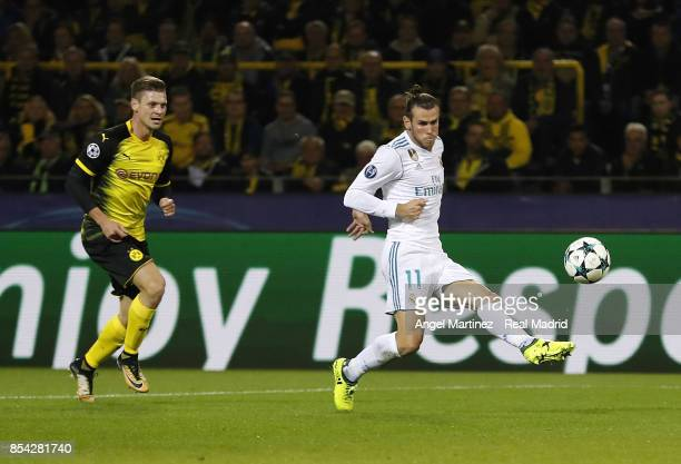 Gareth Bale of Real Madrid scores the opening goal during the UEFA Champions League group H match between Borussia Dortmund and Real Madrid at Signal...