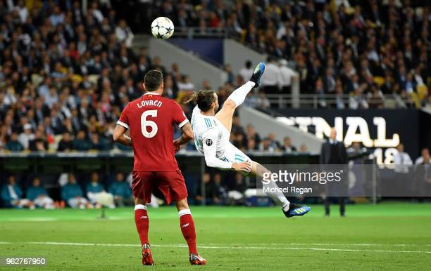 Gareth Bale of Real Madrid shoots and scores his side's second goal during the UEFA Champions League Final between Real Madrid and Liverpool at NSC...