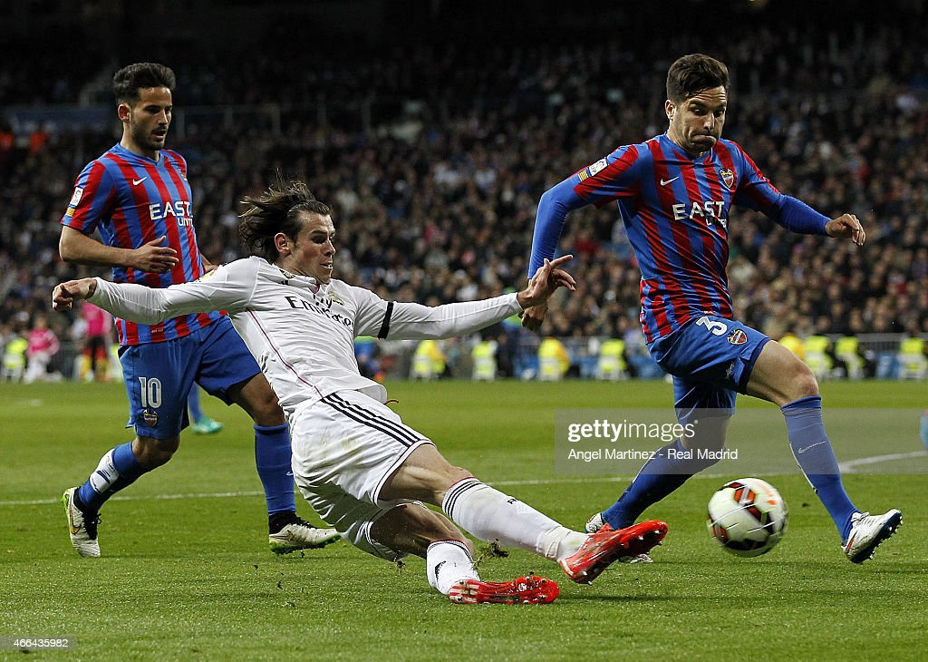 Gareth Bale of Real Madrid shoots on goal past Tono Garcia of Levante UD during the La Liga match between Real Madrid CF and Levante UD at Estadio Santiago Bernabeu on March 15, 2015 in Madrid, Spain.