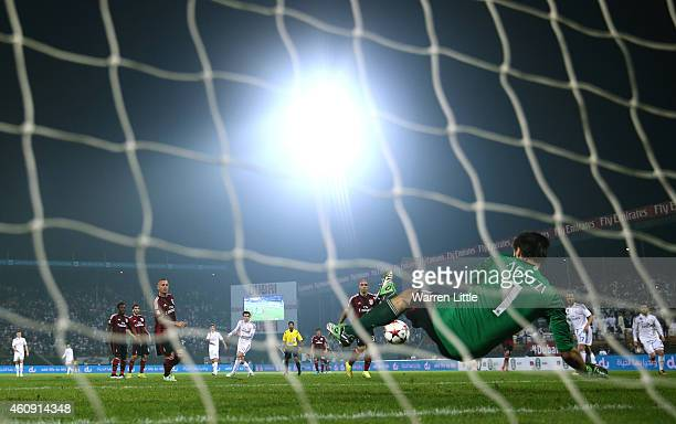 Gareth Bale of Real Madrid strikes at goal saved by Michael Agazzi of AC Milan during the Dubai Football Challenge match between AC Milan and Real...