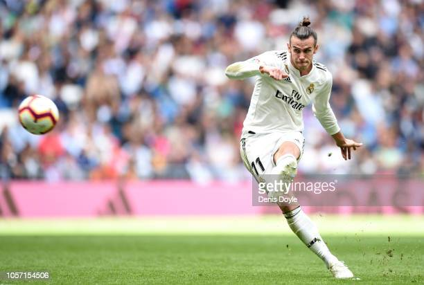 Gareth Bale of Real Madrid takes a free-kick during the La Liga match between Real Madrid CF and Levante UD at Estadio Santiago Bernabeu on October...