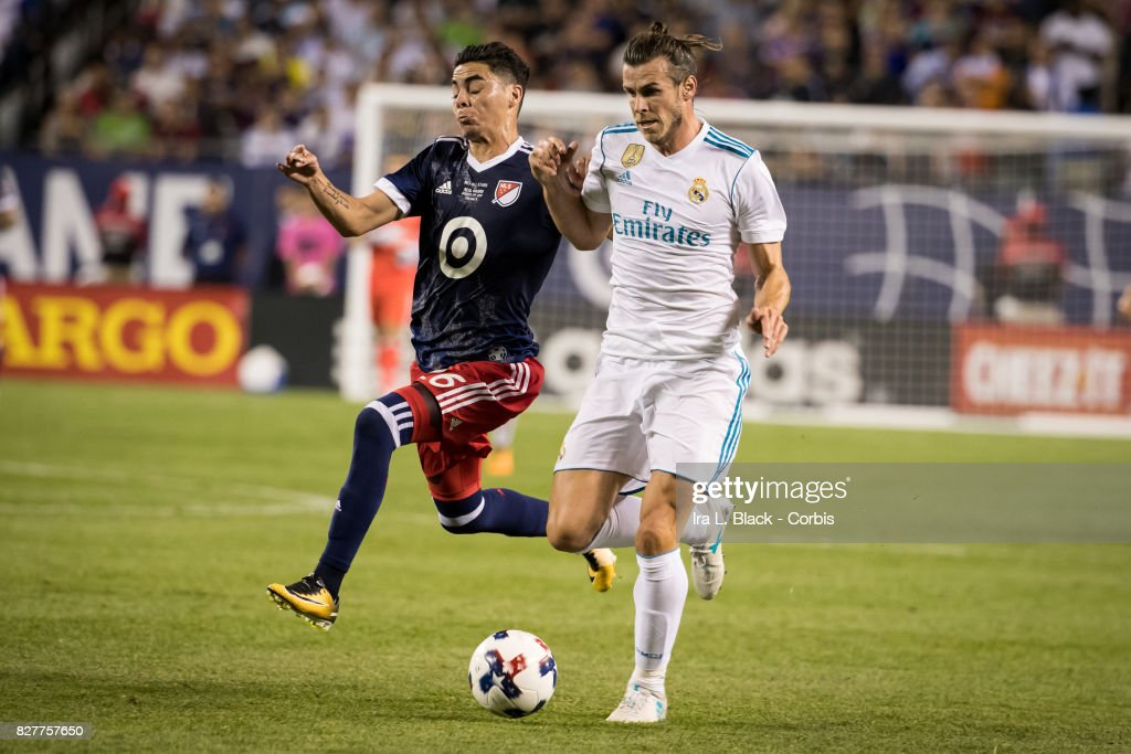 Gareth Bale #11 of Real Madrid tangles it out with Miguel Almiron #26 of the MLS All-Star team during the MLS All-Star match between the MLS All-Stars and Real Madrid at the Soldier Field on August 02, 2017 in Chicago, IL. The match ended in a tie of 1 to 1. Real Madrid won the match on a 4 to 2 in penalty kicks.