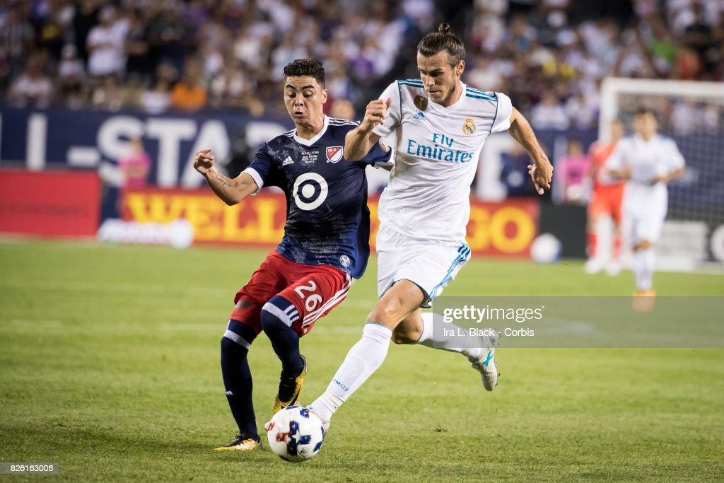 Gareth Bale #11 of Real Madrid tries to keep off the pressure from Miguel Almiron #26 of United States during the MLS All-Star match between the MLS All-Stars and Real Madrid at the Soldier Field on August 02, 2017 in Chicago, IL. The match ended in a tie of 1 to 1. Real Madrid won the match on a 4 to 2 in penalty kicks.