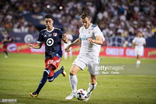Gareth Bale of Real Madrid tries to keep off the pressure from Miguel Almiron of United States during the MLS AllStar match between the MLS AllStars...