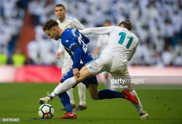 Gareth Bale of Real Madrid tries to take the ball from Alvaro Medran of Deportivo Alaves during the La Liga match between Real Madrid and Deportivo...