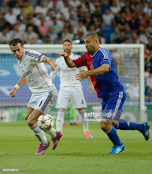 Gareth Bale of Real Madrid vies for the ball with Walter Samuel of FC Basel during the UEFA Champions League Group B soccer match between Real Madrid...