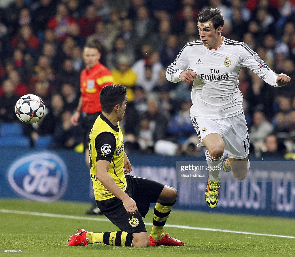 Gareth Bale (R) of Real Madrid vies with Nuri Sahin of Borussia Dortmund during the UEFA Champions League Quarter Final first leg match between Real Madrid and Borussia Dortmund at Estadio Santiago Bernabeu on April 2, 2014 in Madrid, Spain.