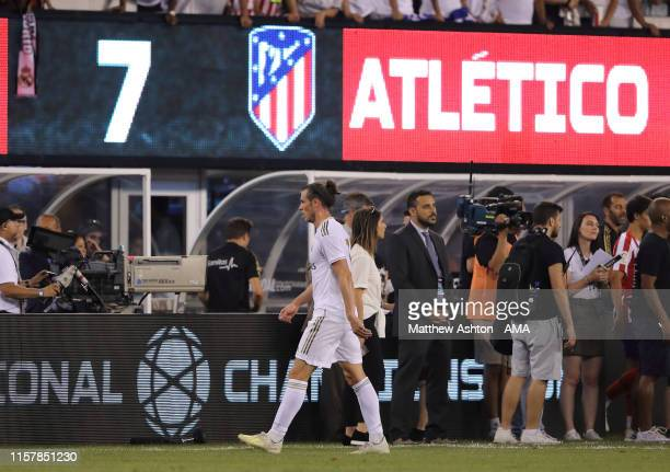 Gareth Bale of Real Madrid walks past the scoreboard showing the final score of Real Madrid 3 7 Atletico de Madrid at the final whistle of the 2019...