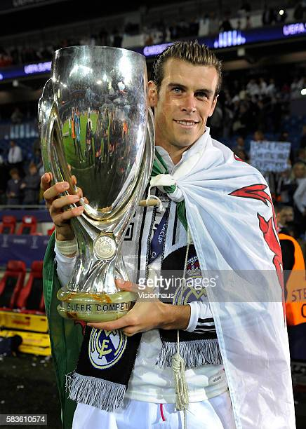Gareth Bale of Real Madrid with the trophy after winning the UEFA Super Cup Final between Real Madrid and Sevilla at the Cardiff City Stadium in...