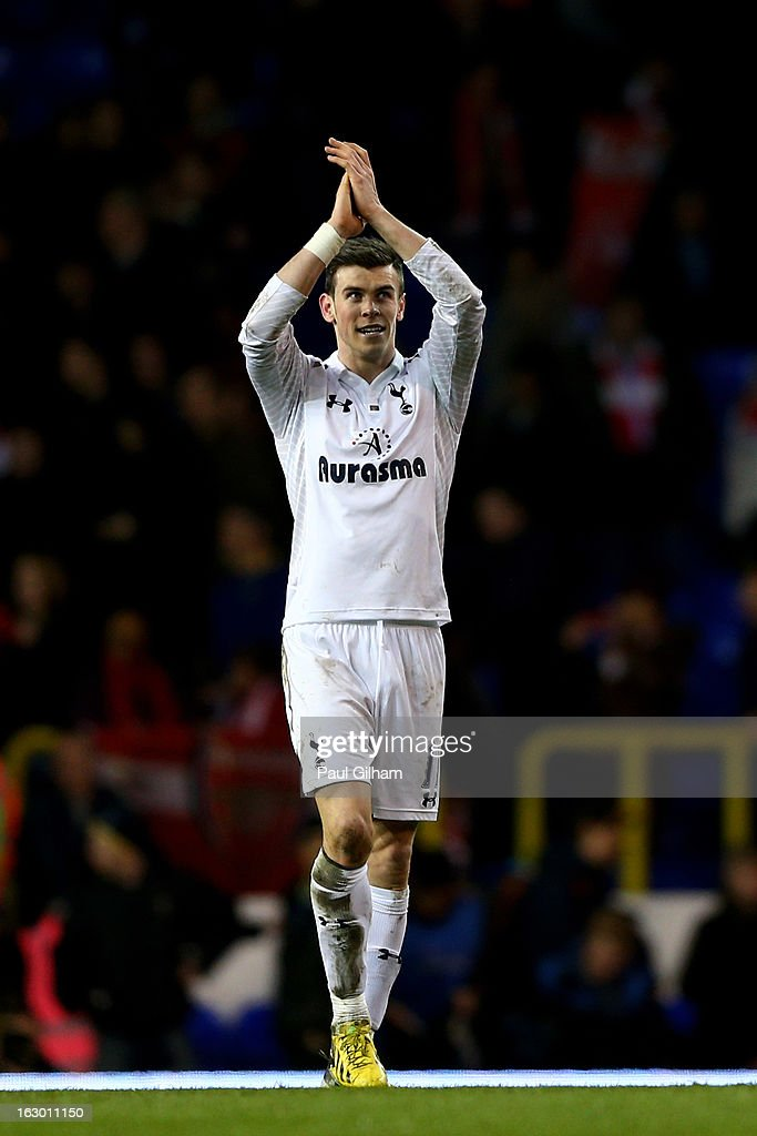Gareth Bale of Spurs celebrates following his team's 2-1 victory during the Barclays Premier League match between Tottenham Hotspur and Arsenal FC at White Hart Lane on March 3, 2013 in London, England.