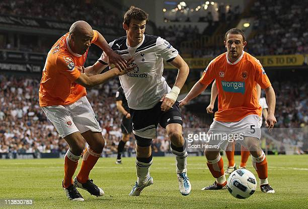 Gareth Bale of Spurs tries to find a way through Neal Eardley and Alex Baptiste of Blackpool during the Barclays Premier League match between...