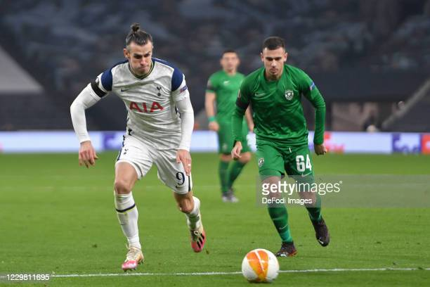 Gareth Bale of Tottenham Hotspur and Dominik Yankov of Ludogorets battle for the ball during the UEFA Europa League Group J stage match between...