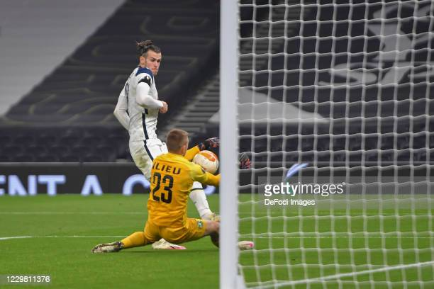 Gareth Bale of Tottenham Hotspur and goalkeeper Plamen ILIEV of Ludogorets battle for the ball during the UEFA Europa League Group J stage match...