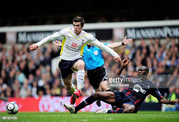 Gareth Bale of Tottenham Hotspur avoids a challenge from Fabrice Muamba of Bolton Wanderers during the Barclays Premier League match between...