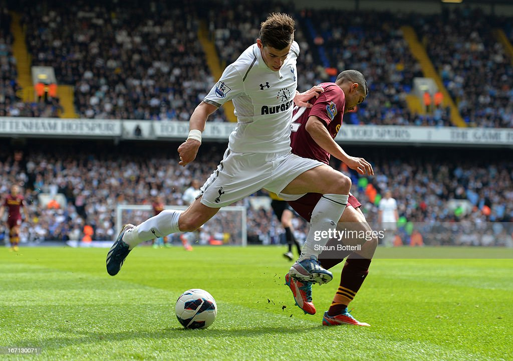 Gareth Bale of Tottenham Hotspur battle for the ball with Gael Clichy of Manchester City during the Barclays Premier League match between Tottenham Hotspur and Manchester City at White Hart Lane on April 21, 2013 in London, England.