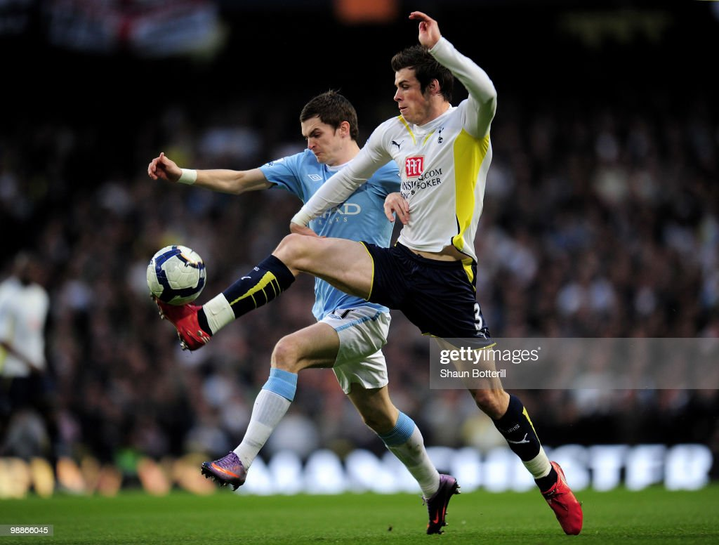 Gareth Bale of Tottenham Hotspur battles for the ball with Adam Johnson of Manchester City during the Barclays Premier League match between Manchester City and Tottenham Hotspur at the City of Manchester Stadium on May 5, 2010 in Manchester, England.