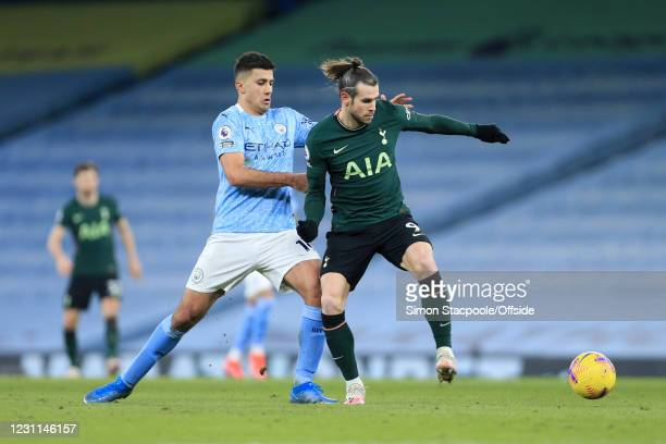 Gareth Bale of Tottenham Hotspur battles with Rodri of Manchester City during the Premier League match between Manchester City and Tottenham Hotspur...