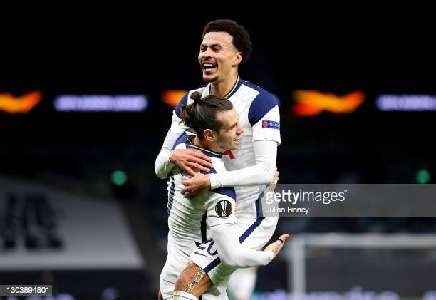 Gareth Bale of Tottenham Hotspur celebrates with Dele Alli after scoring their team's third goal during the UEFA Europa League Round of 32 match...