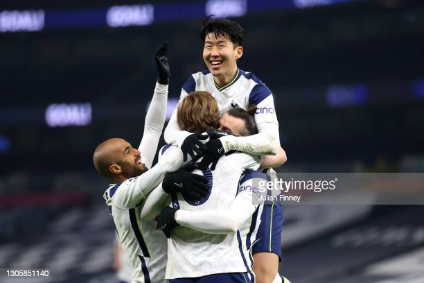 Gareth Bale of Tottenham Hotspur celebrates with Harry Kane, Lucas Moura and Son Heung-Min after scoring their side's second goal during the Premier...