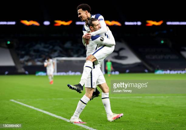 Gareth Bale of Tottenham Hotspur celebrates with team mate Dele Alli after scoring their side's third goal during the UEFA Europa League Round of 32...