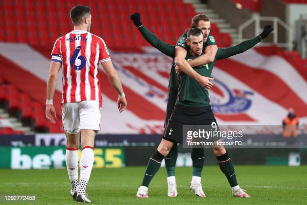 Gareth Bale of Tottenham Hotspur celebrates with team mate Harry Kane after scoring their sides first goal during the Carabao Cup Quarter Final match...
