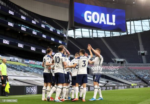 Gareth Bale of Tottenham Hotspur celebrates with team mates after scoring their side's first goal during the Premier League match between Tottenham...