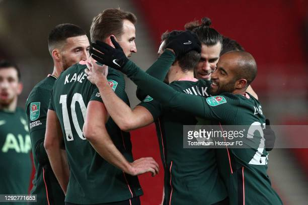 Gareth Bale of Tottenham Hotspur celebrates with team mates Matt Doherty, Harry Kane, Harry Winks and Lucas Moura after scoring their sides first...