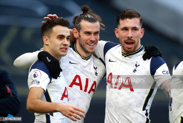 Gareth Bale of Tottenham Hotspur celebrates with team mates Sergio Reguilon and Pierre-Emile Hojbjerg after scoring their side's fourth goal during...
