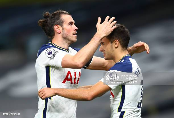 Gareth Bale of Tottenham Hotspur celebrates with teammate Sergio Reguilon after scoring his sides second goal during the Premier League match between...