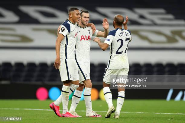 Gareth Bale of Tottenham Hotspur celebrates with teammates Carlos Vinicius and Lucas Moura after his sides second goal came from a own goal by Andres...