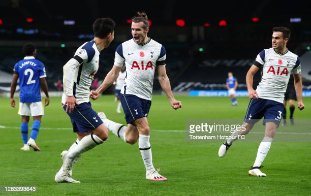 Gareth Bale of Tottenham Hotspur celebrates with teammates Heung-Min Son and Sergio Reguilon after scoring his sides second goal during the Premier...