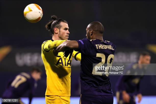Gareth Bale of Tottenham Hotspur clashes with Kevin Theophile-Catherine of GNK Dinamo Zagreb during the UEFA Europa League Round of 16 Second Leg...