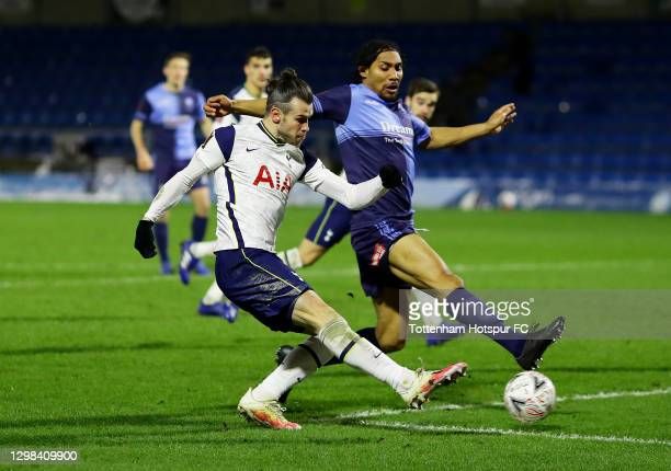 Gareth Bale of Tottenham Hotspur has a shot on goal under pressure from Darius Charles of Wycombe Wanderers during The Emirates FA Cup Fourth Round...