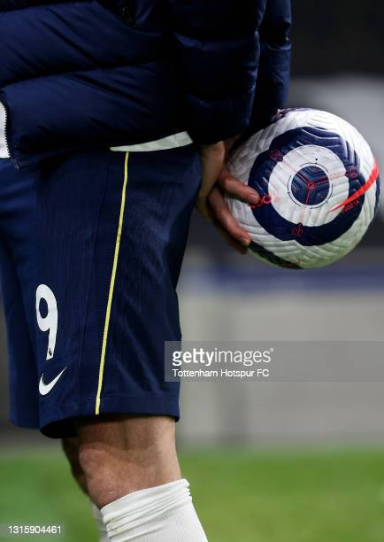 Gareth Bale of Tottenham Hotspur holds the match ball after scoring a hat trick in the Premier League match between Tottenham Hotspur and Sheffield...